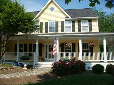 the yellow siding and large porch would prefer white