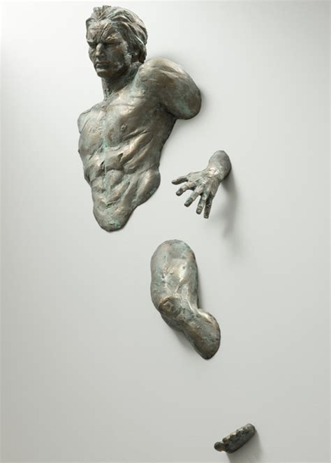 figurative sculptures embedded in gallery walls by matteo
