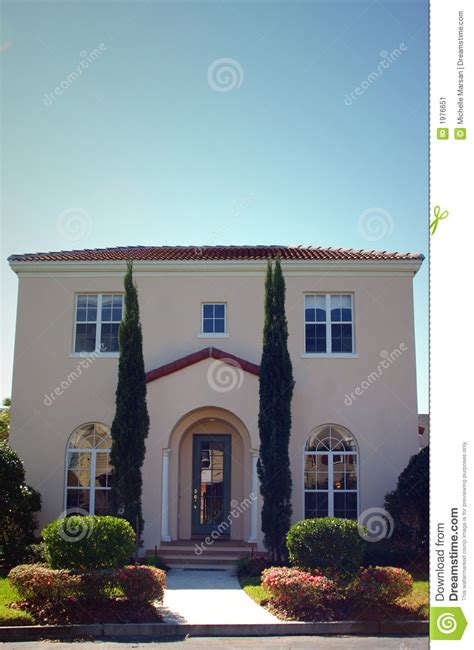 style home with trees at entrance stock image