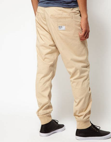 bench chinos bench carrot fit chinos in beige for men cream lyst