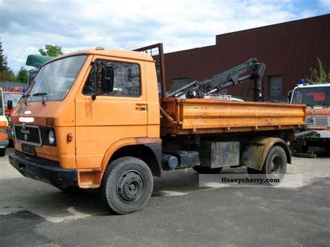man vw   tipper  rear crane  km  tipper truck photo  specs