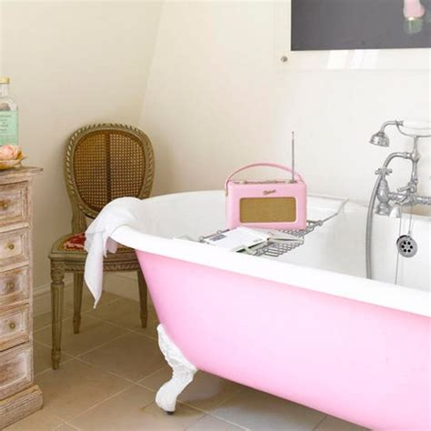 pink bathroom with matching vintage style radio