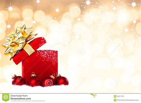 magical christmas gift background with red baubles royalty