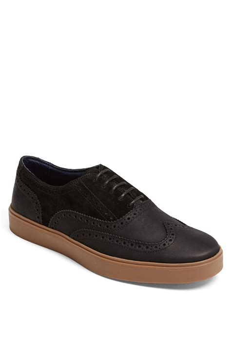wingtip sneakers cole haan bergen wingtip sneaker in black for lyst