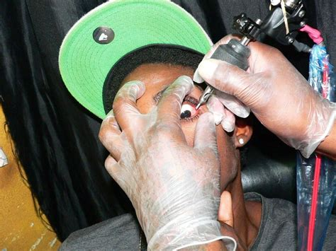 eyeball tattoo artist jamaican dancehall artists are blinding themselves by