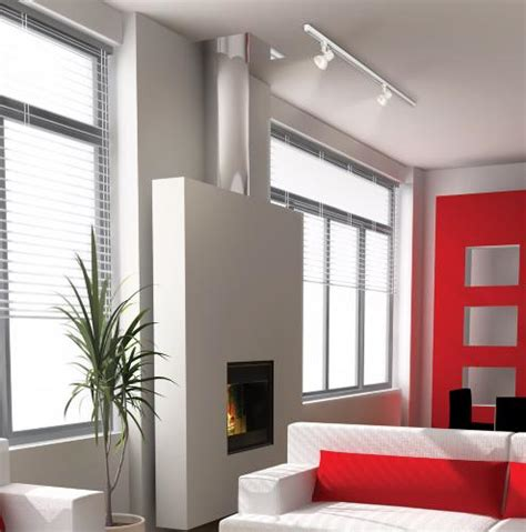 track lighting living room track lighting illuminates a fireplace in a modern living room room inspiration ls plus