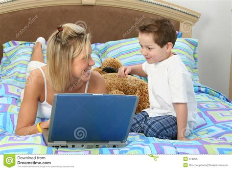 mom son bed mother and son with laptop in bed royalty free stock photo