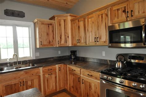 rustic hickory cabinets black laminate countertops ge country style rustic hickory farmhouse kitchen