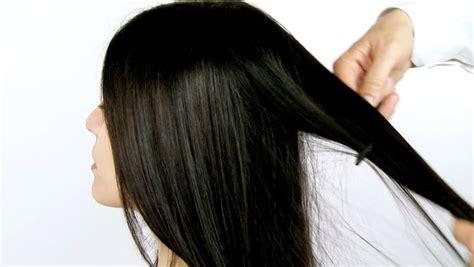 long hait back shot beautiful shiny long black hair being combed and