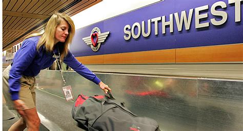 southwest airlines baggage policy southwest s profits dive could checked baggage fees be