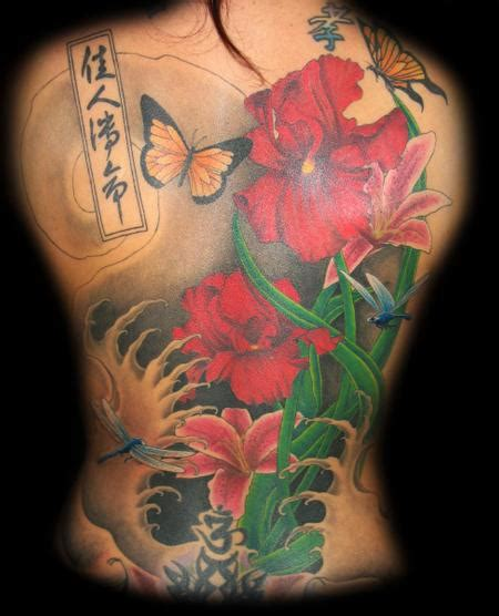 Tattoo Flower Pieces | floral back piece by jared preslar tattoos