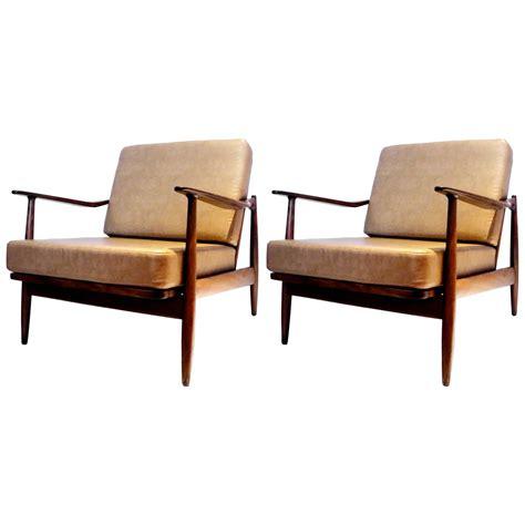 pair of 1950s danish modern walnut finish club chairs by