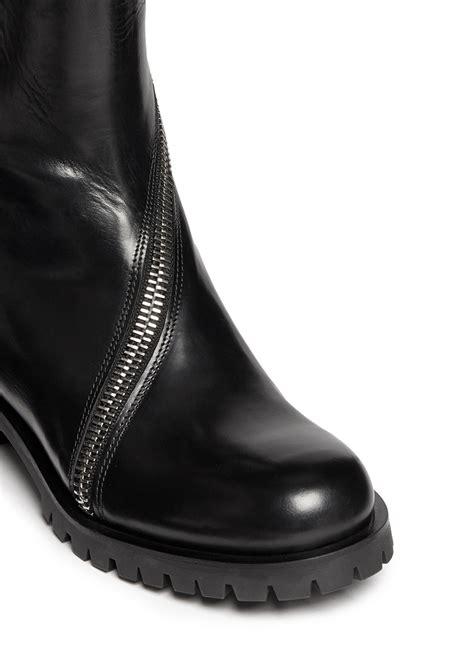 mcqueen boots lyst mcqueen curve skull zip leather boots in