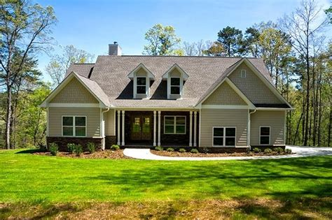 one story lake house plans 2 story 2 car garage rustic lake house plan serenbe