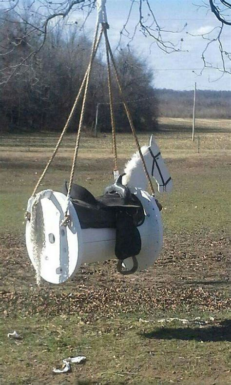 horse swing   cable spool  real saddle