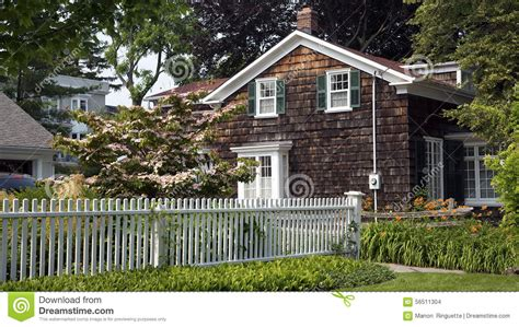 cottage picket fence white picket fence and cottage stock photo image 56511304