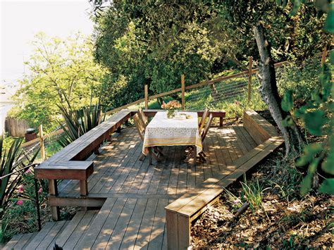 how to make a sloped backyard flat new deck and stairs tame a slope sunset magazine