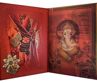 radha krishna wedding card in crimson golden colour