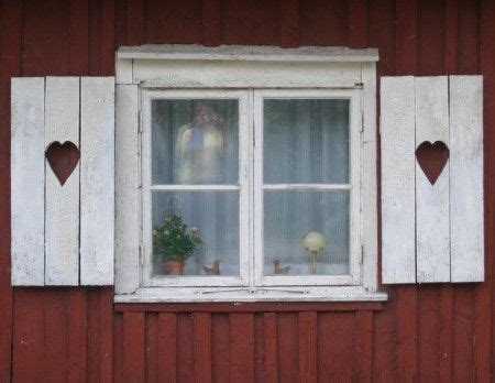 swedish windows  heart shutters swedish cottage