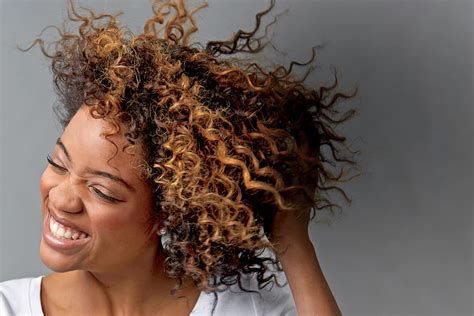 stunning curly holiday hairstyles southern living boost beautiful curls how to fight frizz southern living