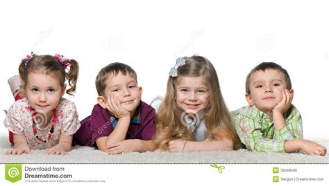 soap two girls and one boy four children lying on the carpet stock photo image 35048590