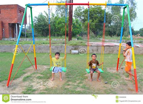 kids swing india kids playing with swing editorial photo image 33608096