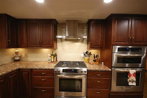 cambria kitchen cabinets starmark chestnut with java island and cambria shirebrook countertops cherry kitchens