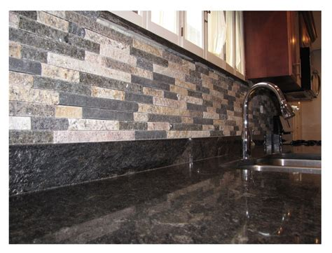 mixed color thin veneer as a backsplash in a kitchen