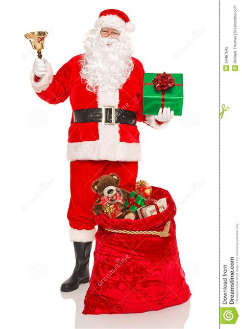 images of christmas father santa with gifts and a bell royalty free stock photo