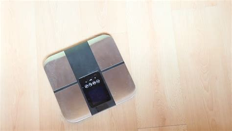 stand up bathroom scales woman put off slippers stand up on modern scales in
