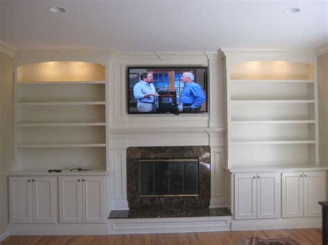 custom built mantle cabinets and bookshelves