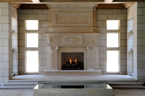 Big Fireplaces large limestone fireplace mantel