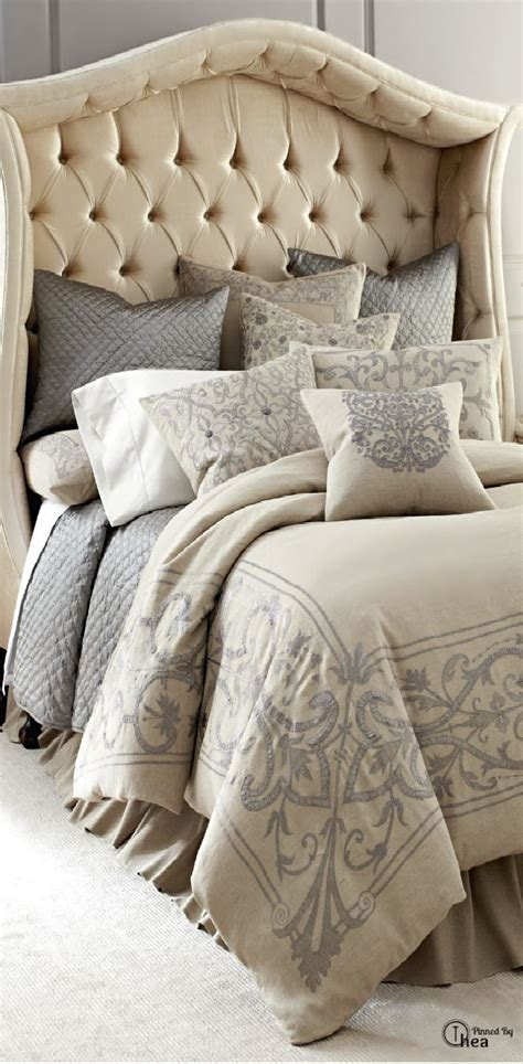beautiful tufted headboard with sumptuous linens suite