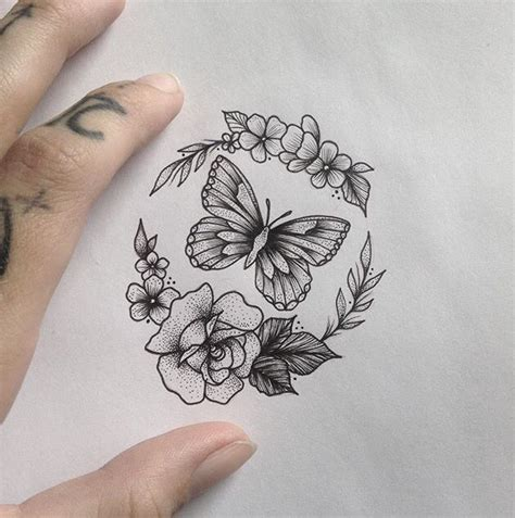 unique tiny tattoo idea butterfly amp flowers tattoo by