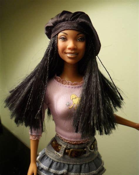 black doll on bed black dolls matter un ruly