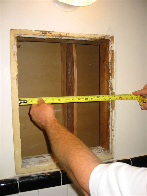 installing recessed medicine cabinet in load bearing wall how to install a medicine cabinet hayneedle
