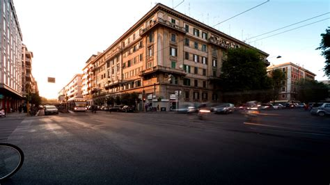 st corner time lapse of busy traffic on a street corner in rome
