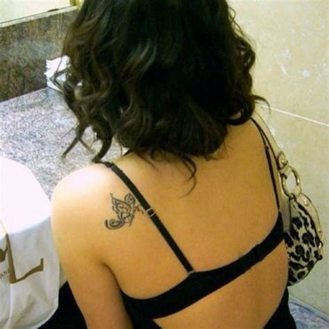 is a tattoo on your shoulder blade painful shoulder blade tattoo of a butterfly on silky