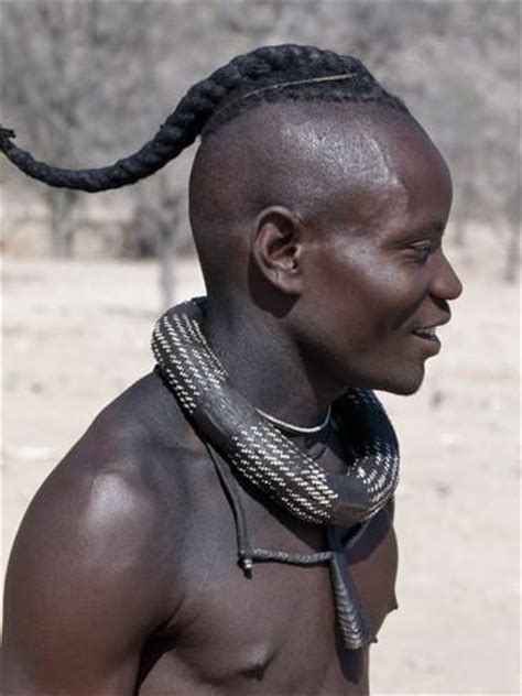african culture plait hair himba youth has his hair styled in a long plait known as