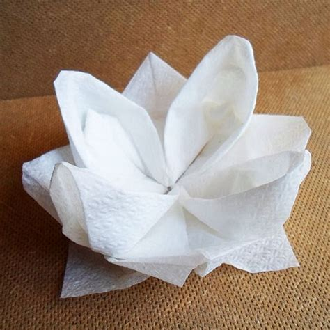 Folded Paper Napkins - how to make an origami waterlily out of a napkin via