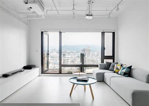 interior design man apartment clean minimalist apartment with a window overlooking the