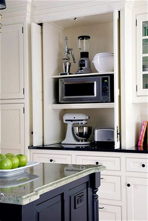 pocket doors to hide kitchen appliances a must in a dream 33 insanely clever upgrades to make to your home