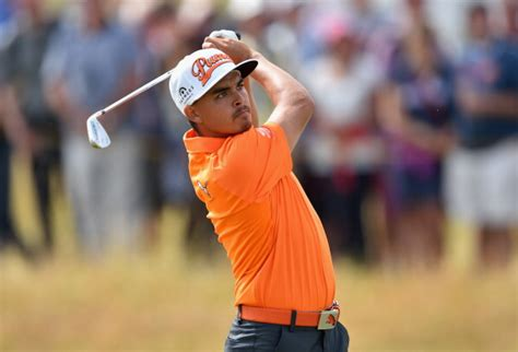 rounded golf swing rickie fowler of the united states hits an approach shot