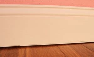 install baseboards along crooked floors managing home