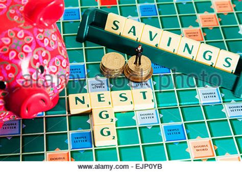 is quid a scrabble word coins spelling out money stock photo royalty free image