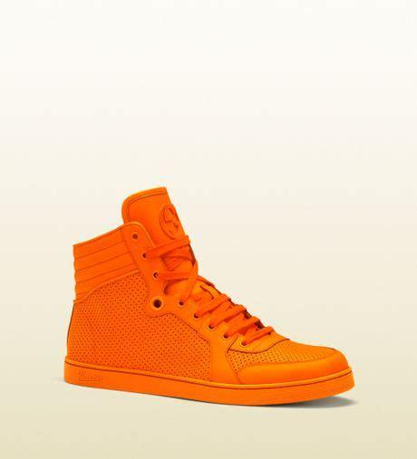 neon orange sneakers gucci neon orange leather hightop sneaker in orange for