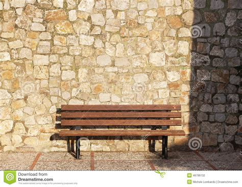 empty bench an empty bench stone blocks background stock photo