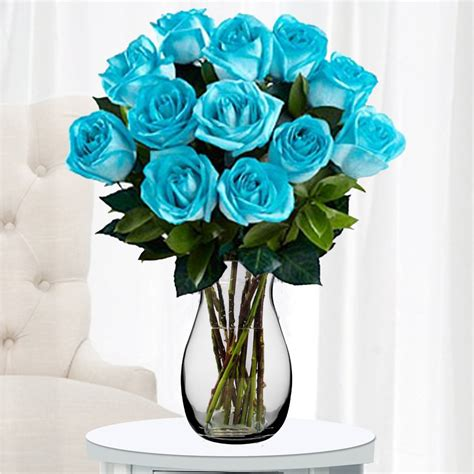 Teal Flowers In Vase by A Unique Flowers Delivery Made Up Of Bright Aquamarine