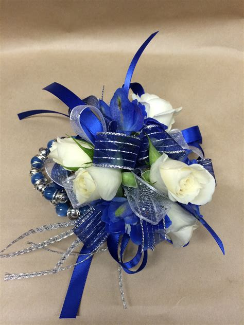 Corsage Blue Silver a wrist corsage featuring white tea roses and blue