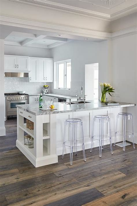 dolomite countertop kitchen peninsula with charles ghost bar stools